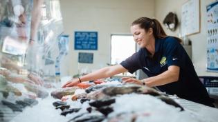 Selecting fresh seafood at a local fish market