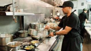 A cook working the line at taverna san marco in jacksonville florida
