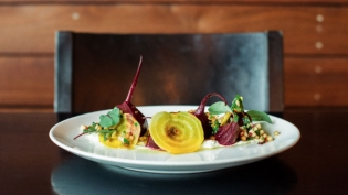 Salt-Roasted Red and Yellow beets on plate with green apple gremolata at Black Sheep