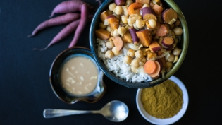 sweet potato medley on plate with peanut sauce on side