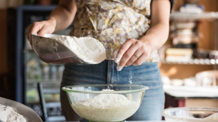 Adding Flour to Sourdough starter at community loaves in jacksonville florida