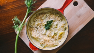 fennel gratin in pan with fennel frond